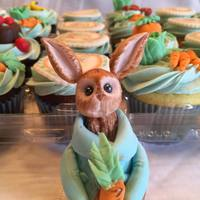 Peter Rabbit Baby Shower Cupcakes In these Beatrix Potter themed cupcakes there is a mixture of edible images and modeled and hand painted fondant pieces.