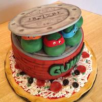 Teenage Mutant Ninja Turtle Cake  I pulled elements from several TMNT cakes I've seen online. Thank you for the wonderful ideas everyone!Everything was decorated...