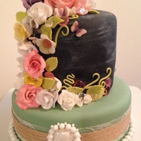 Chalkboard And Roses Cake  This Cake was made using gumpaste roses Isomalt gems and candy coated chocolate pearls. the cake was white and chocolate sponge cake, with...