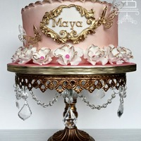 Girly Pink Cake This cake was for Maya who just turned 2 years old. The brief was something pink, girly with flowers and butterflies.Gold scroll work is a...