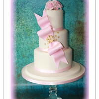 Simplicity 3 tier wedding cake with gold sequins and beautiful light pink bow with light pink roses