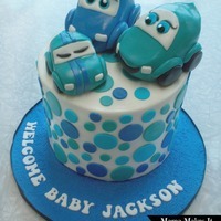 Car Baby Shower Cake 8 inch chocolate chocolate chip cake with cream cheese filling and Vanilla Swiss meringue buttercream covered with caramel flavored...