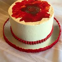 Red Poppy Chocolate filled with nutella cake adorned with a red poppy edible image.