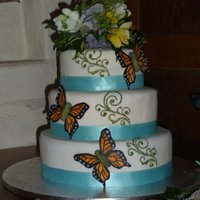 Butterfly Wedding Cake A butterfly wedding cake for my brothers wedding.Hand painted pastillage butterfly wings - but I wasn't happy about the bodies, too...