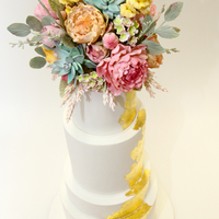 Golden Path Wedding Cake Damask roses, peonies, succulents, snap dragons, wax flower, astilbe and seeded eucalyptus top this four tier wedding cake created for a...