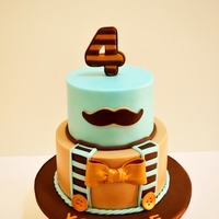 Moustache   I enjoyed making this cutie :) client wanted a simple elegant blue and beige cake with moustache, original design by Cuteology Cakes