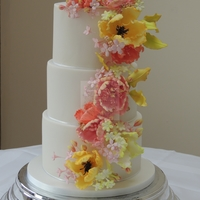 Spring Wedding Cake My first wedding cake filled with wired flowers and filler flowers, loved making this x