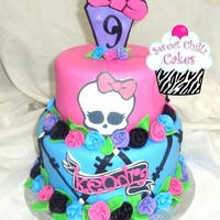 Monster High  Monste High cake covered in fondant. Did black stripes in an X formation around the bottom tier to create the stitching effect. rolled...