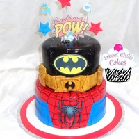 Super Heroes  A super heroes cakeI made, with specific instructions from the client and a pic to follow with her alterations. All fondant, top tier was...
