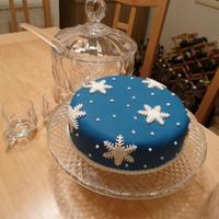 Christmas Cake Christmas cake with blue fondant and white fondant cutout snowflake pattern.