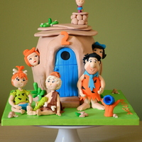 The Flintstones double barrel cake, with gumpaste figures. Yabadabadoo!