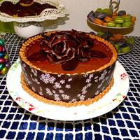 Chocolate Wrapped Cake With Modelling Chocolate Roses Chocolate Transfer ribbon border and modelling chocolate rose topper