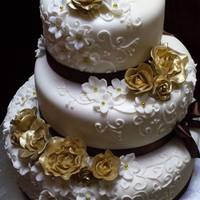 Gold And Brown Wedding Cake - Unique Cakes Roses made from gum paste and painted with Gold dust