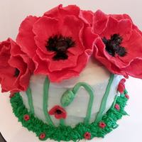Poppy Cake Modeling chocolate red poppies with a lemon poppy seed cake and cream cheese frosting.
