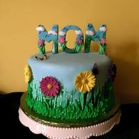 Mother's Day Cake I made the letters out of fondant/gumpaste mix as well as the flowers. I had a lot of fun making this!!
