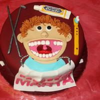 Dentist Cake Yellow sponge cake filled with eggs cream, covered with sugar paste. All edible.