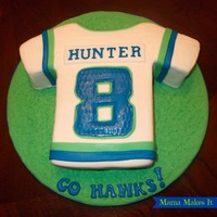 Seahawks Jersey Cake Chocolate cake with mint Oreo filling. Covered with fondant.