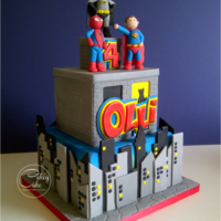 "Superheroes! What is it about 4 year old boys and superheroes?! Another version of my very popular two tier superhero cake. A 7"" chocolate square..."