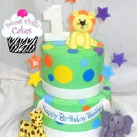 Jungle Animals I was asked to make a bright colourful jungle theme and was given a couple cake pics to use with specific things the client liked from each...