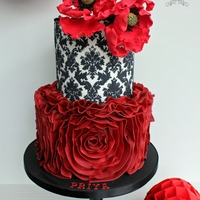 Chic Parisienne This was a surprise Birthday cake for Priya who just turned 18 yesterday.Sugar ruffle and poppy cake with a touch of the Parisienne with a...