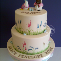 "Beatrix Potter Christening Cake A two tier (bottom 8"" chocolate, top 6"" vanilla) cake covered with vintage ivory sugarpaste and hand painted with meadow grass,..."