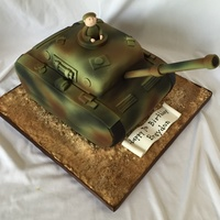 "Military Tank 2 9"" squares, cut, carved and covered with fondant. I then airbrushed the cake to look like camo."