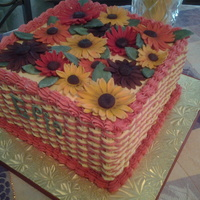 Buttercream Two Tone Basketweave Two Tone Basketweave with Fondant Gerber Daisies.