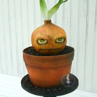 One Grumpy Onion I love that my kids inspire me to keep my sense of humor when it comes to cake. My oldest son, Logan, is a big Plants vs Zombies fan, so I...