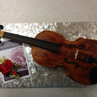 Violin I made this last year for my daughter's Orchestra Banquet. The neck is not edible. It is a raw wood piece that I bought on eBay. I...
