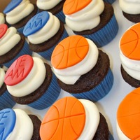 Basketball Cupcakes Chocolate cake with Oreo filling and vanilla buttercream. Topper are made out of fondant.
