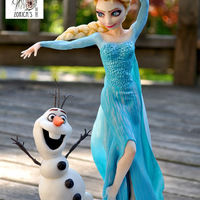 Elsa And Olaf Topper They made from fondant with tylose. Elsa's size is matches with a barbie doll. She has a full wire support armature. Olaf bulked up...