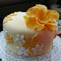 Cake With Flowers Had so much fun making this cake for my husband grandmother. Loved how the yellow tones cameout.