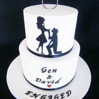 "Engagement Silhouette 8"" and 6"" white chocolate mud cakes layered and iced in white chocolate ganache and then covered in fondant. Silhouette is hand..."