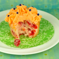 Cherry Almond Cupcakes The moist cake and fluffy frosting combined with hidden bursts of color and flavor make this cherry almond cupcake a unique crowd-pleaser...