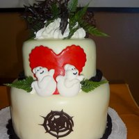 """ghoulish"" Wedding Cake Two tiered red velvet fondant cake, a ghostly couple in love!"