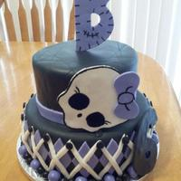Monster High Cake  This cake is a monster high theme two tier birthday cake. I have been doing cakes from home for awhile now and feel this is my best one so...