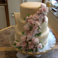 Roses & Pearls Wedding Cake Vanilla Buttercake with Strawberry filling (Top & Bottom Tier); Pineapple middle tier; fondant roses & pearls