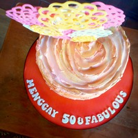 50 & Fabulous Chocolate cake with chocolate filling and Vanilla Swiss Meringue buttercream. The topper is made out of chocolate candy melts.
