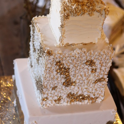 Square 3 Tier Wedding Cake In Gold And Ivory With Hundreds Of Sugar Flowers