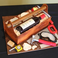 Toolbox Cake This cake was for the 60th birthday celebration of a retired carpenter, who loves red wine and cheese. I made a cake in the shape of a...