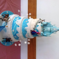 4 Tier Frozen Cake 4 tiers of sponge cake of different flavours. The castle is made of gumpaste.