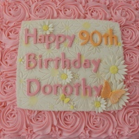 90Th Birthday Cake Pink buttercream rosettes. Gumpaste plaque, daisies, letters made with Wilton letter and number molds.