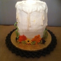 Candle Centerpiece This was done back last year for the Holidays as a centerpiece. It was buttercream covered and fondant drippings and leaves, with a...