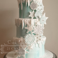 Frozen Snowflake Cake Snowflakes design is made using fondant discs, gumpaste snowflakes and the Cake Lace Crystal Mat.I coloured my cake lace with pale teal and...