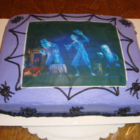 Ghosts Of The Haunted Mansion Red Velvet cake with Buttercream Icing.