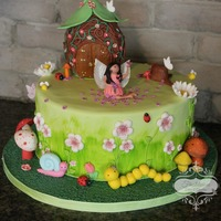 "Garden Fairy Cake 10"" chocolate cake with chocolate buttercream. All decorations made out of fondant except for the fairy's wings which are made..."