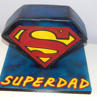 Standing Superman Sign Cake I made this for my partner for father's day using my cake frame. Bottom point is mars rkt and the rest is vanilla and chocolate marble...