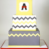 Chevron Birthday Cake This cake with a neutral color palette of yellow and grey with a pop of red was designed to match a birthday party theme.