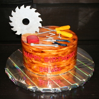 Wood Worker's Birthday Cake   All of the tools are made with sugar paste using moulds I made myself, then painted. I