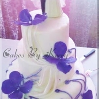 Purple And White Wedding Cake Purple and White Wedding cake.